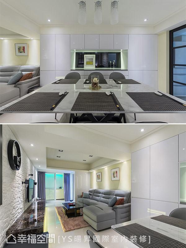 一整面以白色烤漆打造的餐边柜,展现干净利落的现代感,中间特地保留开放置物平台,底部贴饰镜面具有双倍财运的风水意涵。