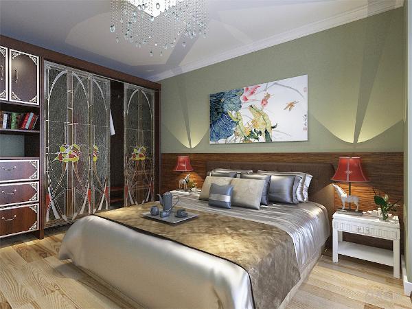 主卧室的设计与整体设计相统一,也以简洁舒适为主。简约的双人床与白色混油床头柜,再搭配上具有储物功能的衣柜,墙上还悬挂着别致的艺术画,还有一个书桌,整体空间简洁明亮极具现代感。