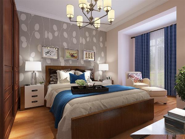 次卧和主卧布局相似,床头背景贴壁纸。挂装饰画做装饰。