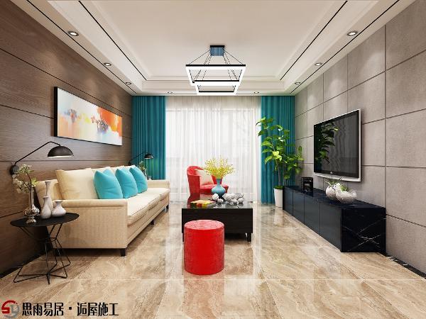 客厅电视背景墙采用硬包,横竖交叉的线条,既简单又大方,沙发背景墙横向的木饰面与电视背景形成了强烈的呼应,再配合吊顶里面镶嵌的不锈钢线条,凸显出极简主义的理念。