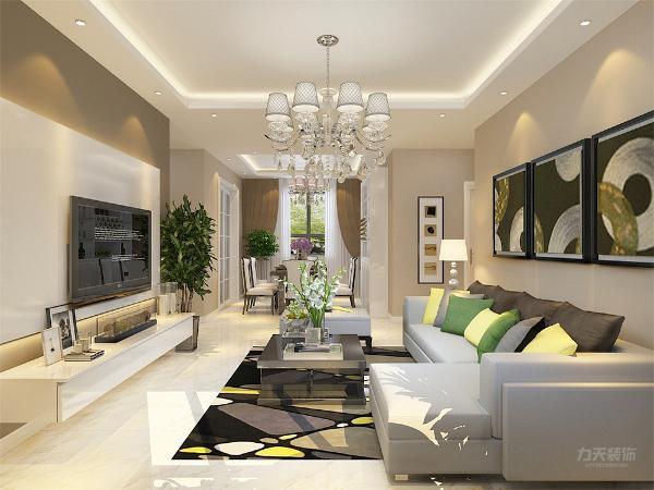 客厅摆放一个L型皮制沙发,旁边配置一个皮质软榻,干净上档次,由于业主喜欢浅色系,所以搭配了亮黄色和浅绿色抱枕,沙发背景墙则简单挂了三幅挂画,电视背景墙是本案设计的亮点