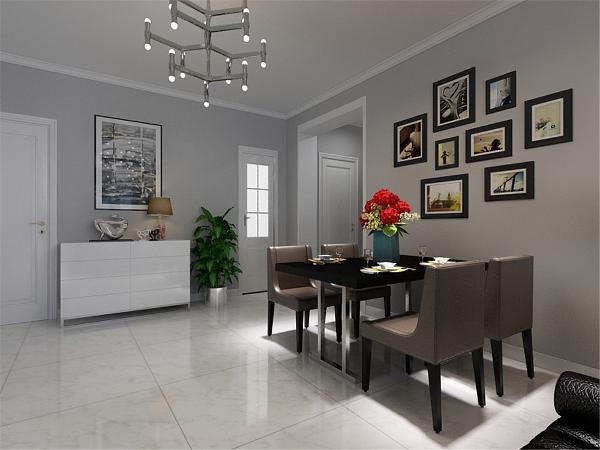 餐厅的设计很简单,餐桌的选择为4人餐桌,墙上做了照片墙,厨房的设计很简单,用深色的墙砖和银灰色的橱柜搭配,整体显得很干净