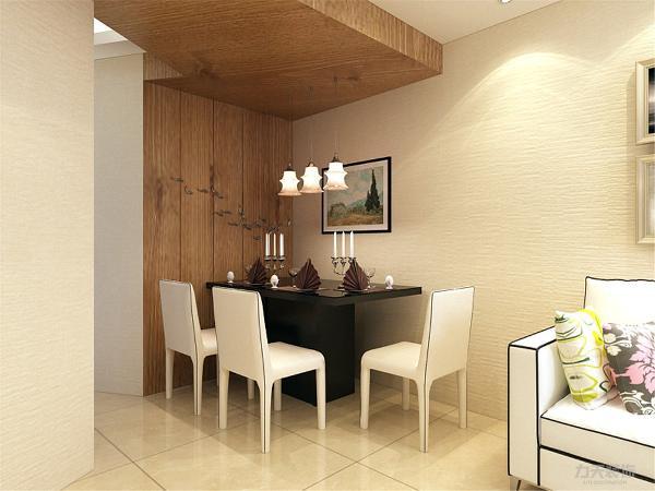 餐厅区域的设计是,采用墙面与吊顶相连的木质铺装,具有现代的气息,餐桌采用的是黑色镜面桌,白色座椅,墙面上配搭的是挂画让空间不具沉闷。
