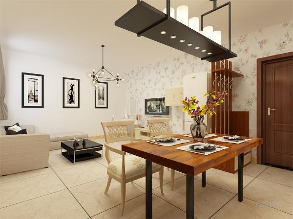 餐厅和客厅相呼应又不重复,餐桌放在入户门口卫生间与厨房中间,虽然空间受限但业主仍可以请亲朋好友来家中聚会,厨房用的组合柜,使空间更具有 整合感