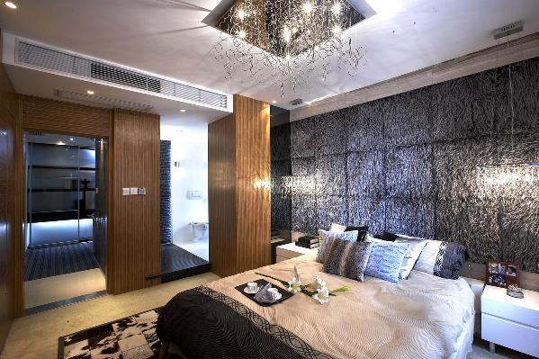 卧室的装修设计,背景墙的设计时尚感很强。