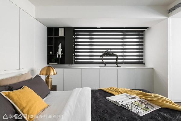 利用系统柜替卧房规划了完善的收纳空间,维持利落清爽的立面视觉。