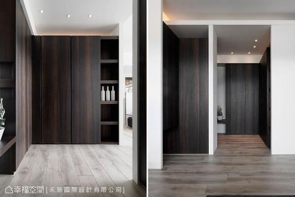 舍弃完全开放的规划,使用深色调木质柜体围塑完整的玄关段落,营造大宅气度的曲进动线。