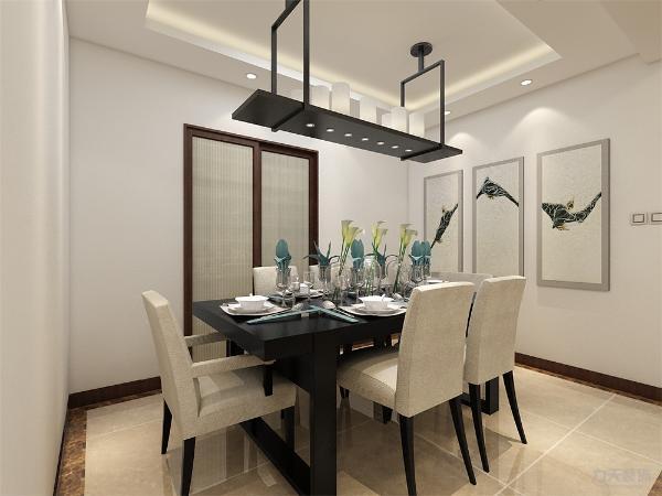 餐厅放了一张六人长桌,餐桌上面是一个长的吊灯。在餐厅背景墙上放了三张画。