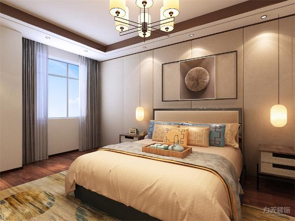主卧室背景墙用石膏板造型,灰、黄、米等色彩元素搭配的床整体体现温馨的感觉,柔和的色调,不会显得混乱