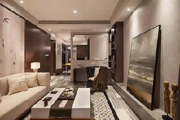 电视墙取消电视柜的布置,以硬装大理石板材造型打造,再摆上一副优雅的艺术画,显得艺术韵味十足