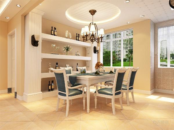 餐厅位于入户门右侧,采用了六人桌椅,还有一个很有设计感的酒柜,大圆形吊顶简单大方,使户主更加舒心。餐厅和厨房临近的厨房之间有面墙,不仅浪费了空间的使用