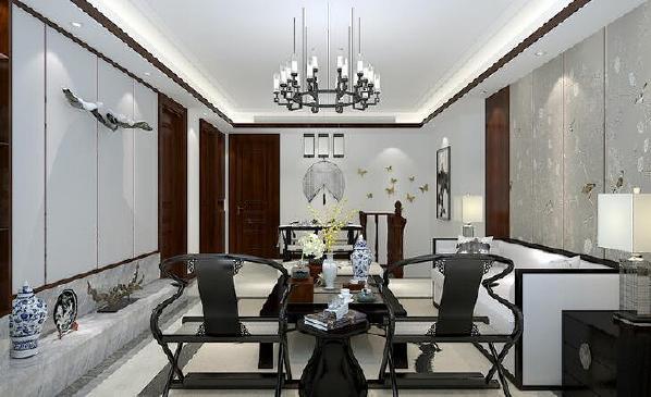 【海昌天澜-客厅】客厅的布置充分利用了大理石材质,用青花瓷瓶来做装饰,传统的元素搭配现代设计手法,武汉全包装修空间颇有特色。