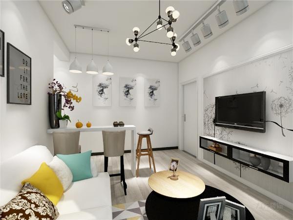 客厅的设计比较动感,电视背景墙采用了石膏线中间圈漆处理,突显出了整个空间的大气,