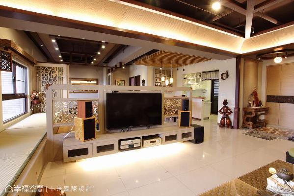 破除实墙式的电视墙印象,以造型矮墙定义电视位置,同时维系开放空间的通透视野。