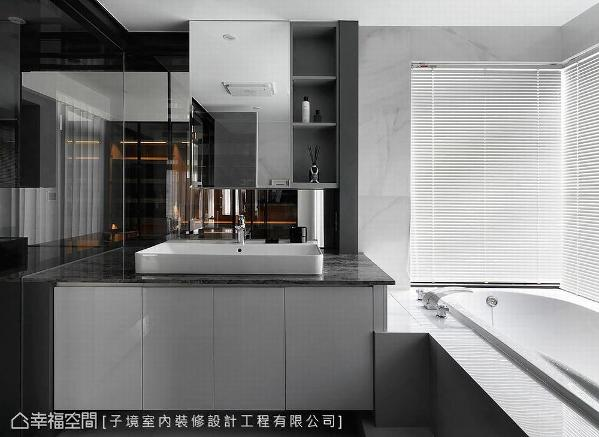 以石材铺饰立面打造利落平滑视感,低彩度设计为空间营造舒适自在氛围。