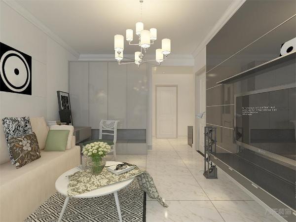 客厅作为待客区域,要稳重,用白色地砖,使整体上宽敞。墙面顶面采用上下两种颜色,这样使视觉上具有层次感,色彩也更加丰富。