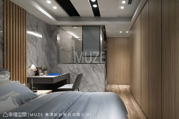 考虑私人空间的使用尺度,主卧房以矮墙的形式连结睡眠区与盥洗区,并使用玻璃、石材与木皮烘托出卧眠的温度。