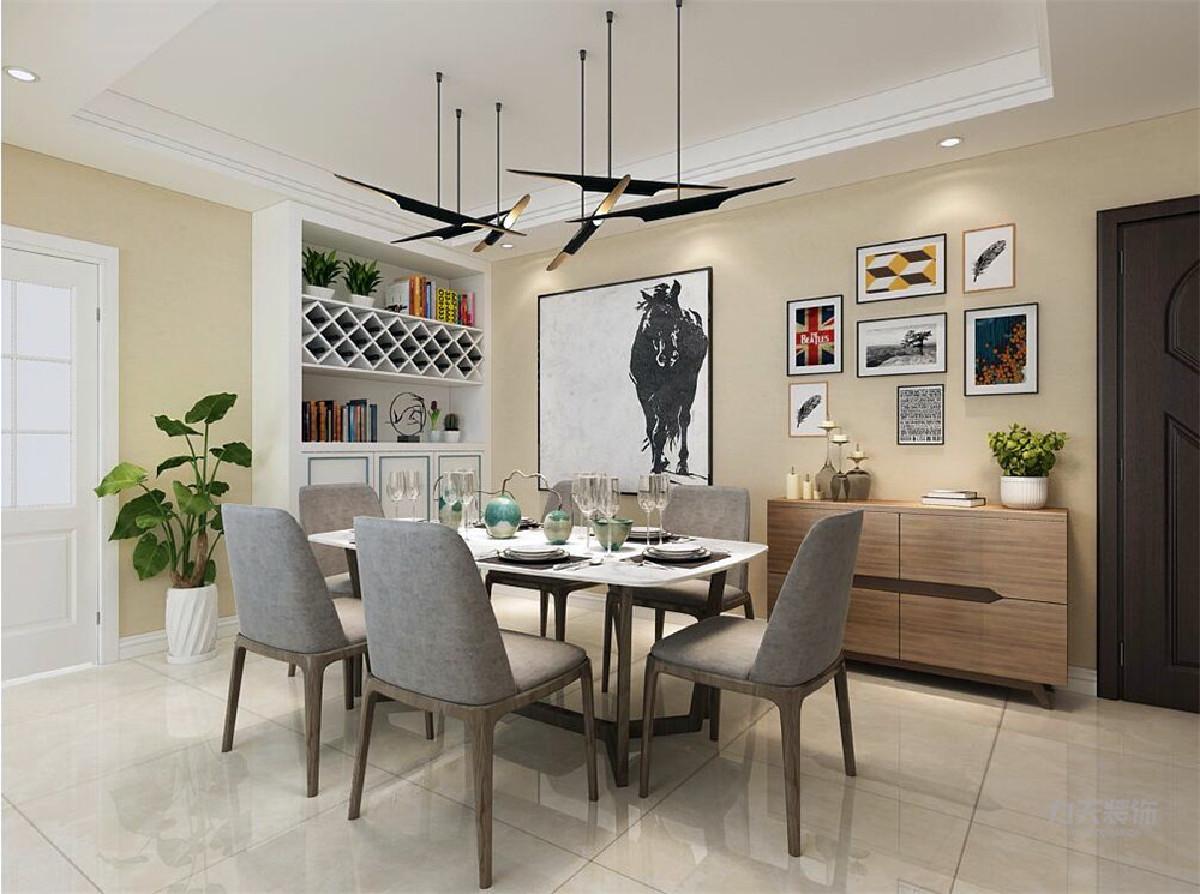 客餐厅一体,空间很大,多少有些空旷,靠门处做了一个酒鬼,增添整体的设计感。灰色的餐桌椅,给餐厅增加了格调感。