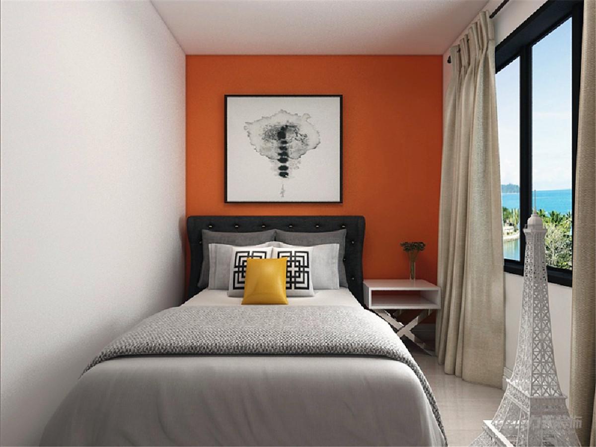 次卧的一张双人床靠墙放置,用埃菲尔铁塔作为装饰。
