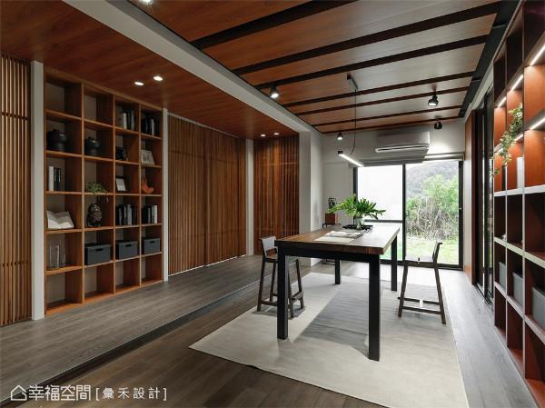 温润收纳柜 以大量实木皮板规划出温润的收纳空间,长形木桌则带来沉淀阅读的氛围。