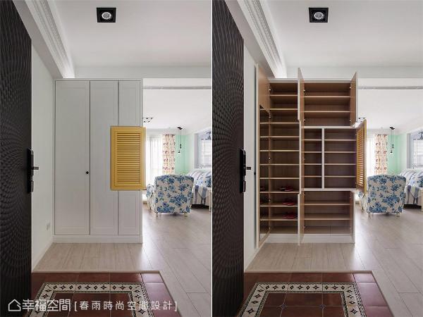 玄关 西班牙复古地砖的后方,白色鞋柜缀点暖黄色百也门片,增添彩度层次。