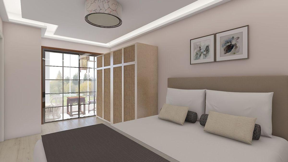 暖色墙面设计给人温馨舒适的感觉。高衣柜设计,满足使用者的日常储物需求。