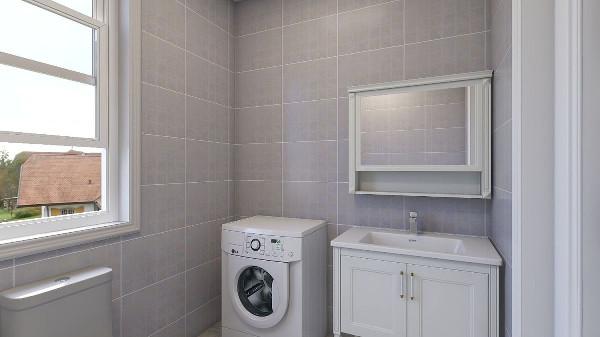 卫生间采用的是浅灰色调,配上白的洁具,使得空间更加宽敞明亮