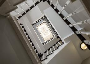 中科大学城 别墅装修 欧美风格 别墅设计师 楼梯图片来自腾龙设计在美式风格别墅装修完工实景的分享