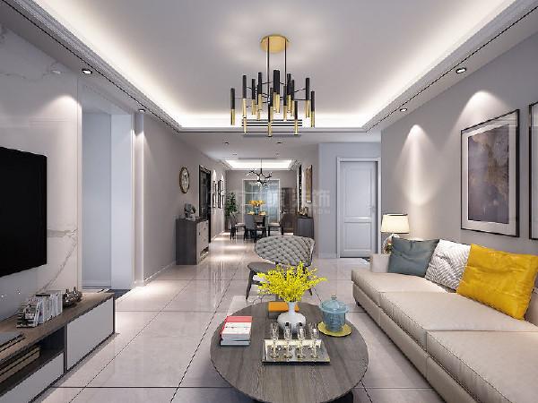 客厅与餐厅整个格局通透,色调统一,最大化的将光线引入室内,大气通透,拉升空间感。