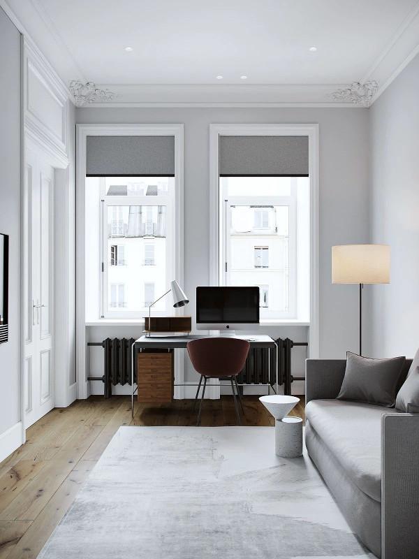 书房只做了简单的布置 灰色的双人沙发 造型奇特的边桌、款式大方的落地灯 组合的挂画、灰色地毯、挂壁电视 衬托出空间纯净与时尚