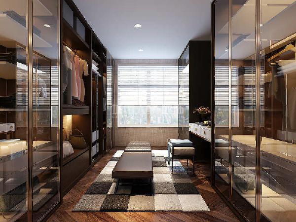长条式衣帽间,两侧布局衣帽柜,达到最佳的衣帽储藏空间和使用习惯,色彩稍深,玻璃门板,突出衣物为衣帽间重点,另外玻璃门板更加方便衣物的收纳。