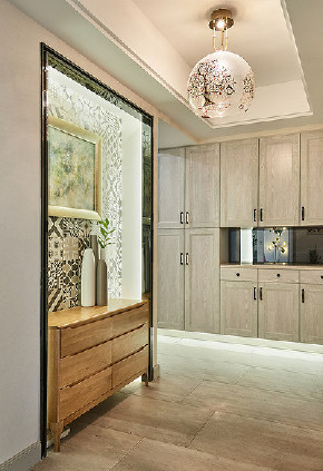 玄关图片来自家装大管家在时尚大气 130平北欧美式混搭3居的分享