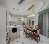开敞的西厨餐厅一体化空间,满足功能化需求的同时,展示性也得到很大提升。极具整体化的高柜设计可以囊括嵌入式冰箱以及内嵌蒸箱烤箱。同时也能与展示酒柜的设计完美结合。