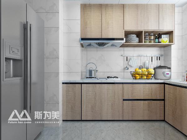 ▲厨房原木色与白色搭配处的清爽简洁,银灰色冰箱的高级感,以及内部使用动线的规划,储物架构的整合,无一例外的将设计师的理念植入其中。