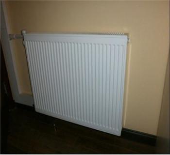 暖气片挂在墙上好吗