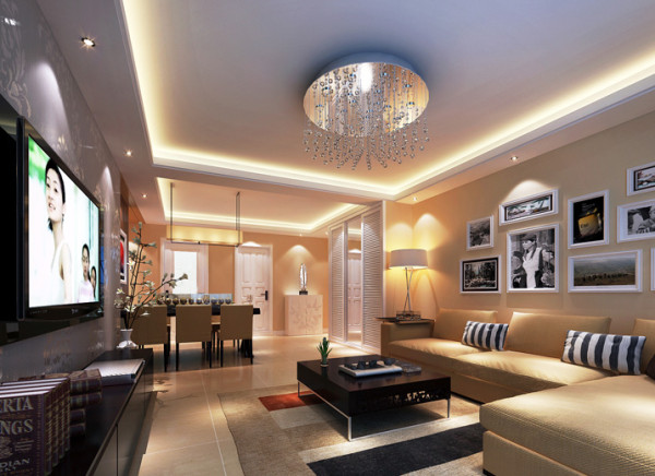 暖黄色的墙壁、地砖,配上暖色调的灯光,尽显温馨舒适之感。沙发背景墙做成照片墙,可以记录一家人的点滴生活还能增添空间的艺术感。