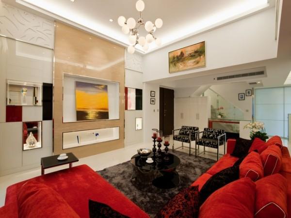 客厅:大理石、不鏽钢、烤漆玻璃与立体凋饰板材,搭以长方形的展示空间,形成独一无二的电视主墙。