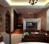 客厅亮点是大理石的电视背景墙,很有感觉。上面悬挂的珠帘将卧室跟客厅巧妙分隔开。