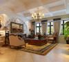 客厅简洁明快,装修较其它空间更明快光鲜,使用石材和木饰面装饰;看着有历史感,同时也使用仿古墙地砖、石材的仿旧工艺。客厅从总体来看是宽敞而富有历史气息的。