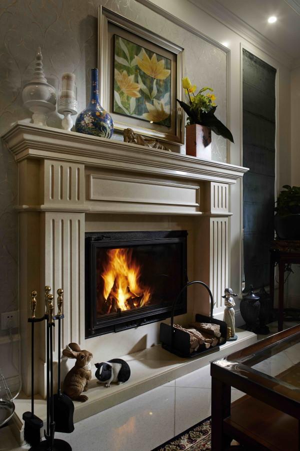 西山林语 420平米 混搭装修风格,壁炉寒冷的冬天,一家人围绕在真火壁炉旁,暖意融融。