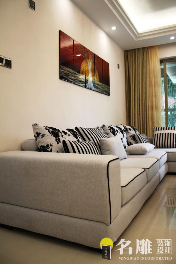 名雕装饰设计———客厅沙发:造型简洁,反对多余装饰,崇尚合理的构成工艺,尊重材料的性能,讲究材料自身的质地和色彩的配置效果。