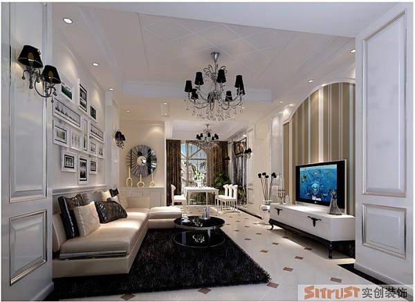 以白色、米黄、浅咖为主基色调,电视背景墙与沙发墙运用装饰饰面板为造型,结合墙纸和挂画等软式,让墙面彰显大气而不失温馨的简欧客厅