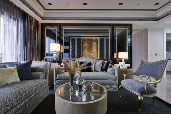 金箔画框层次界定的镜材底墙,运用中轴线概念定位、延伸,开展了客厅与书房的透视性低调互动。
