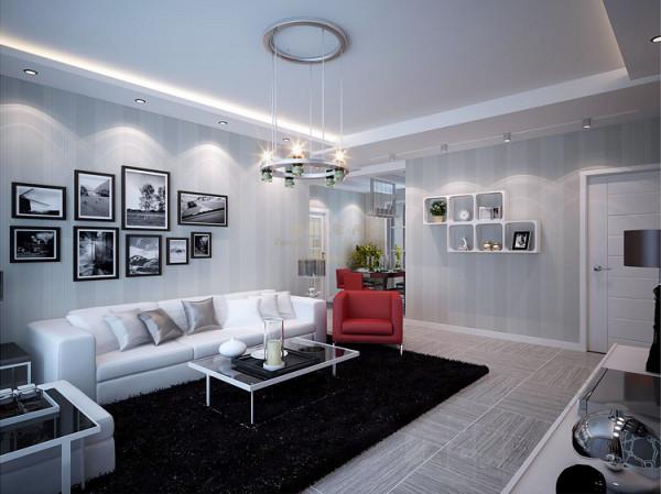 """在色彩上大面积揉进了灰色来平衡黑白过于""""冰""""的感觉,也能提高品质感。比起冷冰冰的乳胶漆墙面,壁纸的运用会更柔和,所以选择了宽条纹的浅灰色壁纸。"""