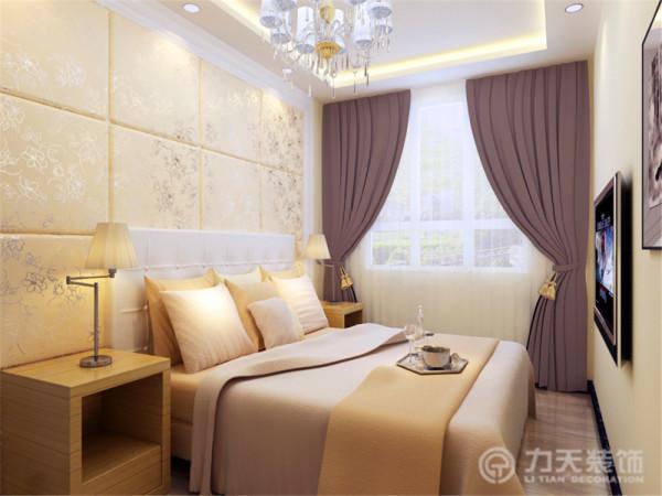 卧室床头背景墙采用软包设计,整体橱柜以白色为主