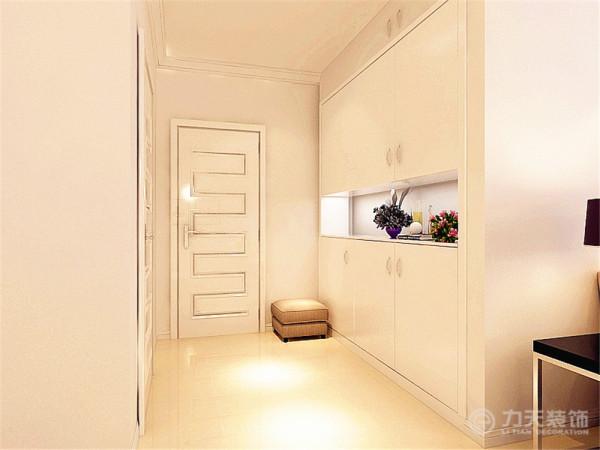 现代简约风格,入户玄关处是鞋柜并放有座椅换鞋时使用
