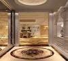 圆形吊顶、白色玻璃明亮玻璃再加上白色储物衣帽柜,一进门给人洁净、明亮之感。