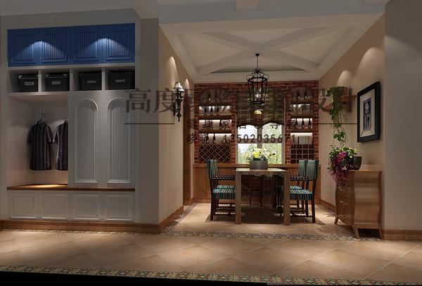 地面用具有特色的波打线将区域进行划分,酒柜选用深色的木质打造,餐桌椅的选择也比较有特色,凸显了主人品位的独特。