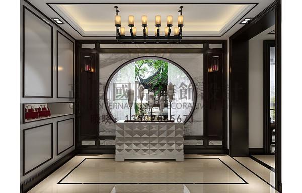 入户的玄关,设计师运用了江南水乡的月亮门做造型,还有壁柜的打制,符合风水学、人体工程学以及人的视觉。