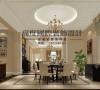 """餐厅选用圆形的吊顶和圆形的餐桌做呼应,地面选用波打线,做到一个""""天圆地方""""。"""
